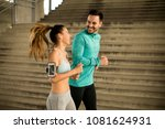 young couple running in urban... | Shutterstock . vector #1081624931