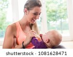 happy mom and newborn baby... | Shutterstock . vector #1081628471
