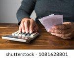 hand on calculator to calculate ...   Shutterstock . vector #1081628801