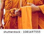 yellow robe of buddhist monks ... | Shutterstock . vector #1081697555