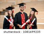 smiling graduates keeping... | Shutterstock . vector #1081699235