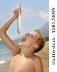 teenager fished on a beach | Shutterstock . vector #108170099