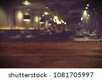 wood table on blur of cafe ... | Shutterstock . vector #1081705997