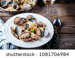 Traditional italian seafood pasta with clams Spaghetti alle Vongole on wooden background