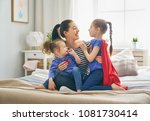 mother and her children playing ... | Shutterstock . vector #1081730414