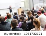 female speaker giving... | Shutterstock . vector #1081732121