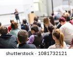 female speaker giving... | Shutterstock . vector #1081732121