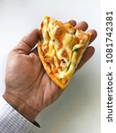 human hand holding a piece of... | Shutterstock . vector #1081742381