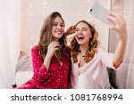 pleased girl in pink pajamas... | Shutterstock . vector #1081768994