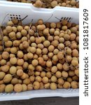 Small photo of Longan in the basket. Longan in Sapindaceae is a tropical and subtropical plant. A medium sized tree. Brown stem Flowering is a bouquet of white, rounded fruit is a bouquet. Raw green peel Ripe brown