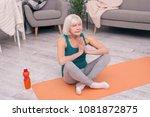 in peace. upbeat senior woman... | Shutterstock . vector #1081872875