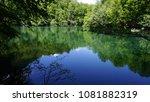 wilderness lake reflections.... | Shutterstock . vector #1081882319