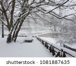 Small photo of Belgrad Forest, the ennobled vast territory of a large famous park in Istanbul, Turkey, winter. A snow-benched bench, branched trees, a wooden fence, stone slopes of hills, on a winter day.