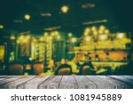 empty wooden table with blurred ... | Shutterstock . vector #1081945889