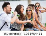 group of young happy friends... | Shutterstock . vector #1081964411