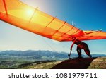 man with hang glider starting... | Shutterstock . vector #1081979711