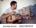 father playing on guitar and...   Shutterstock . vector #1081989059