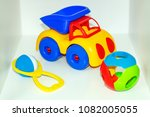 Small photo of Children's toys: rattle, teetotal and plastic truck