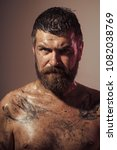 bearded man with tattoo on... | Shutterstock . vector #1082038769