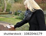 a woman in mourning over the... | Shutterstock . vector #1082046179