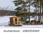 Small photo of Little Sauna, sweatbath, near a typical swedish lake, tradional scandinavian folkway.