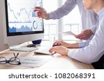 traders discussing trading... | Shutterstock . vector #1082068391