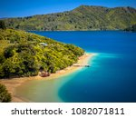 green forest and blue water in...   Shutterstock . vector #1082071811