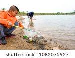 young volunteers with garbage... | Shutterstock . vector #1082075927