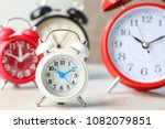 white alarm clock and many... | Shutterstock . vector #1082079851