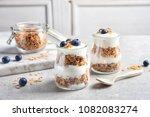 jars with yogurt  berries and... | Shutterstock . vector #1082083274
