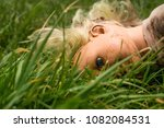 plastic doll facing down in... | Shutterstock . vector #1082084531