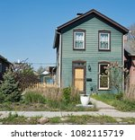 natural teal   brown house with ... | Shutterstock . vector #1082115719