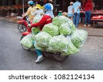 Small photo of A Person on the scooter carrying a bilk of green peas in the street of Can Tho, in Vietnam