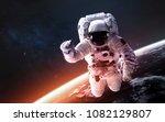 astronaut at spacewalk  earth... | Shutterstock . vector #1082129807