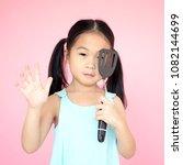 asian little girl holding a...   Shutterstock . vector #1082144699