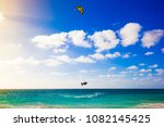 a kite surfer jumping high out... | Shutterstock . vector #1082145425