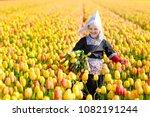 Child In Tulip Flower Field...