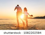couple running and hand hold on ... | Shutterstock . vector #1082202584