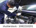 people are repair a car use a... | Shutterstock . vector #1082210201