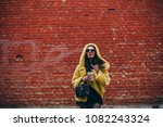 cheerful woman in the street... | Shutterstock . vector #1082243324