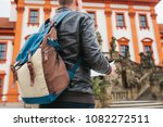 a traveler with a backpack... | Shutterstock . vector #1082272511