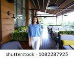 woman standing at street cafe... | Shutterstock . vector #1082287925