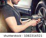 car mechanic screwing or... | Shutterstock . vector #1082316521