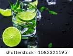 mojito cocktail with lime  ice... | Shutterstock . vector #1082321195