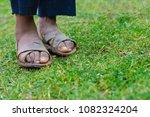feet of poor kid wearing dirty... | Shutterstock . vector #1082324204