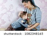 happy cute mother and child boy ... | Shutterstock . vector #1082348165
