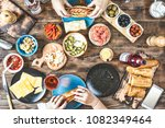 dinner table. happy friends at... | Shutterstock . vector #1082349464