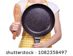 Woman In Apron In Hand Frying...