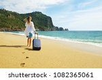 young woman with her suitcase... | Shutterstock . vector #1082365061