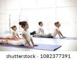little children practicing yoga ...